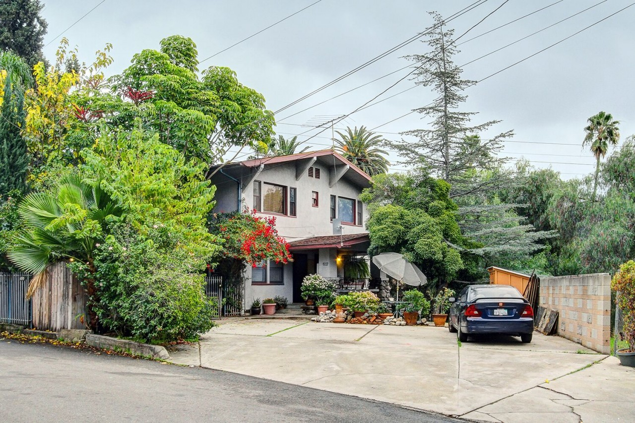 Loads of Potential with this Craftsman-style House on Professor's Row in Highland Park